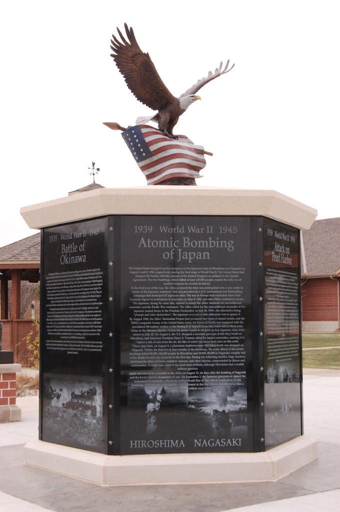 ww2 Memorial, bronze military sculpture, Bald eagle with ww2 American flag, Sutton Betti