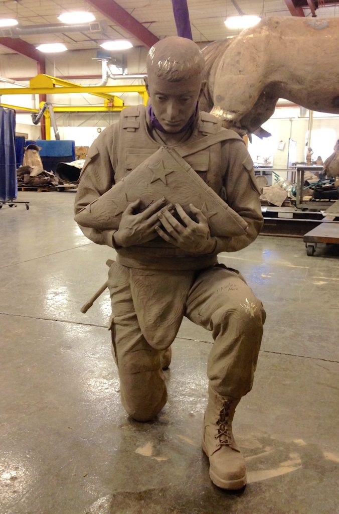 military sculpture, remembering the fallen, remembering our fallen bronze sculpture, soldier with folded flag, marine sculpture, US Marine, Sutton Betti