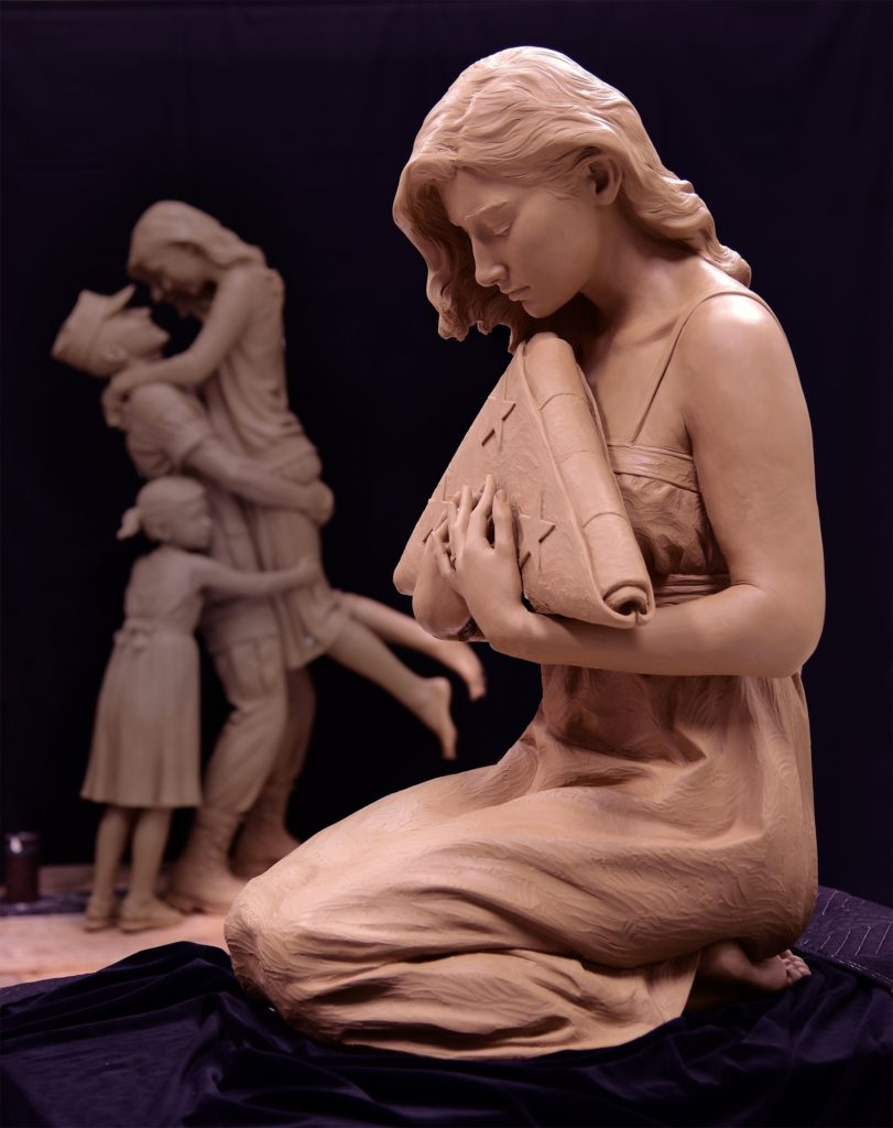 military sculpture, Gold Star wife, grieving woman remembering her husband, remembering the fallen bronze sculpture, Gold star wife with folded flag, folded flag sculpture, Sutton Betti
