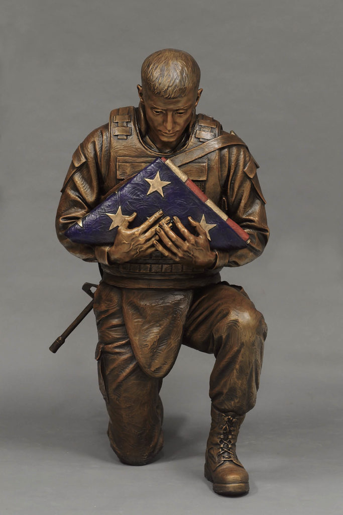 military sculpture, remembering the fallen, remembering the fallen bronze sculpture, soldier with folded flag, marine sculpture, US Marine, Sutton Betti