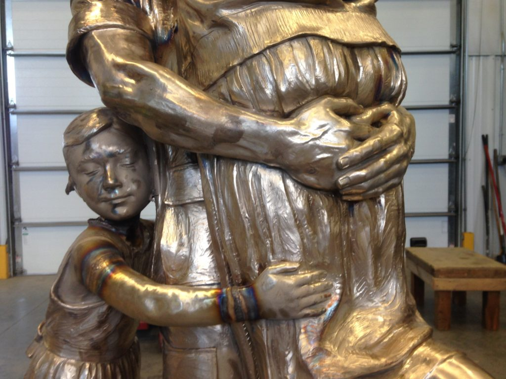 Returning Home statue, after the war, war hero, home safe, military family bronze sculpture, Sutton Betti